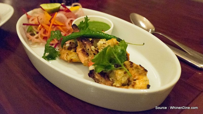 Tandoori Lassoni Jhinga: which is a garlic flavoured prawn, cooked in a tandoor served with a mint sauce